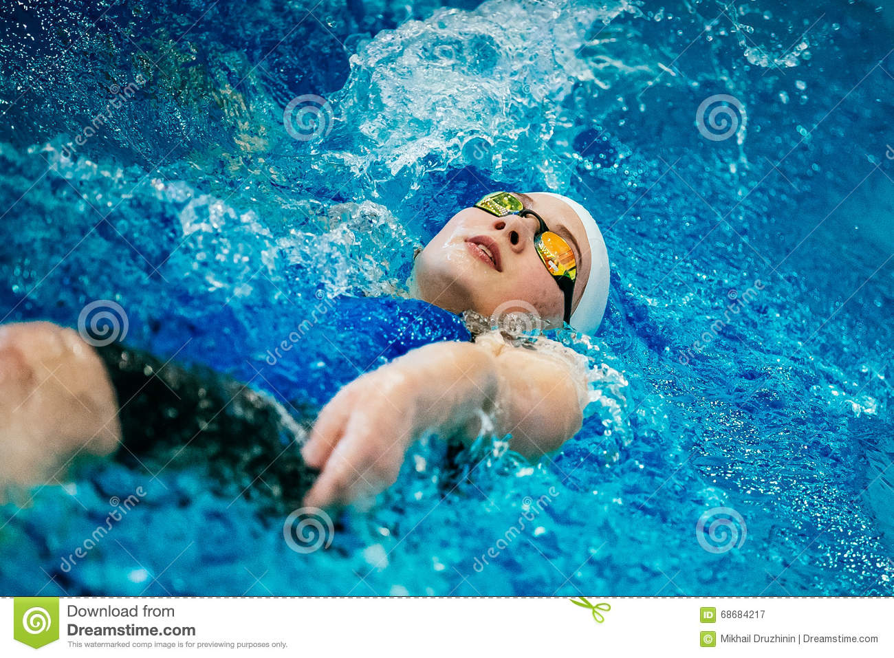 Young female athlete swimming backstroke