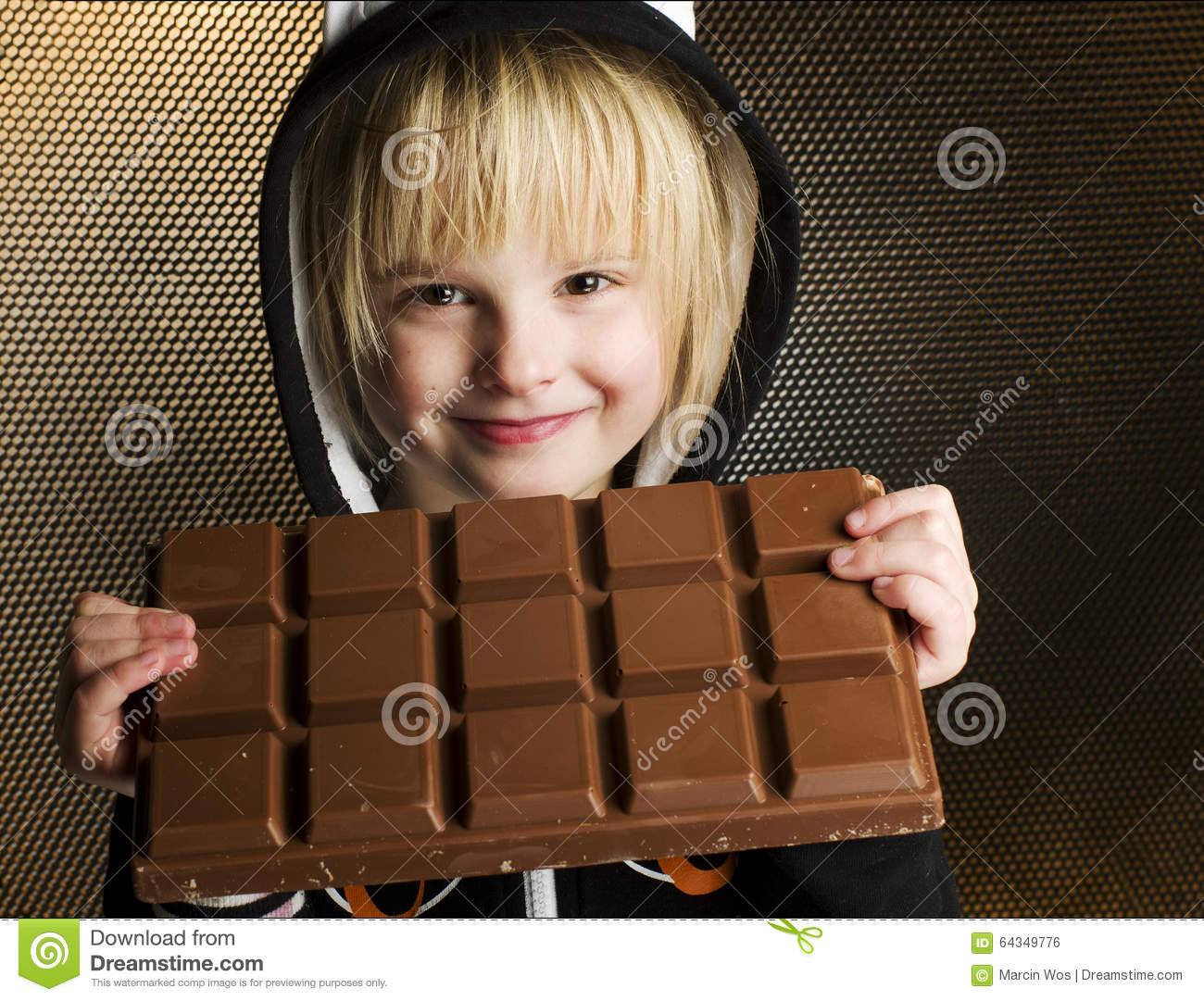 Young Female Child Holding With Both Hands Big Chocolate Bar In ...