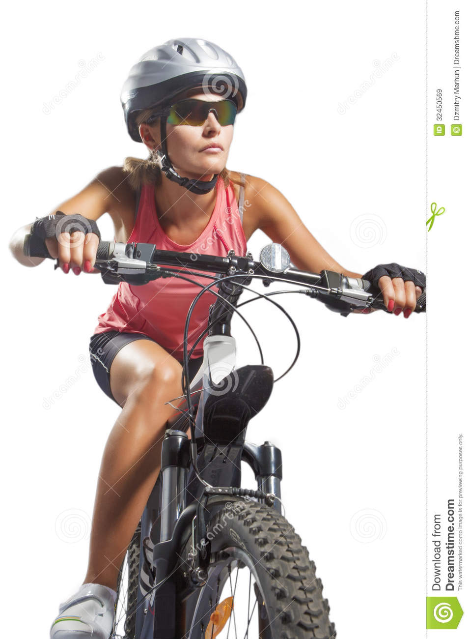 Female cycling athlete riding mountain bike and equipped with ...