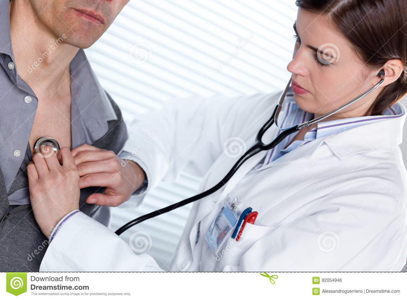 Young female doctor listening to a heartbeat