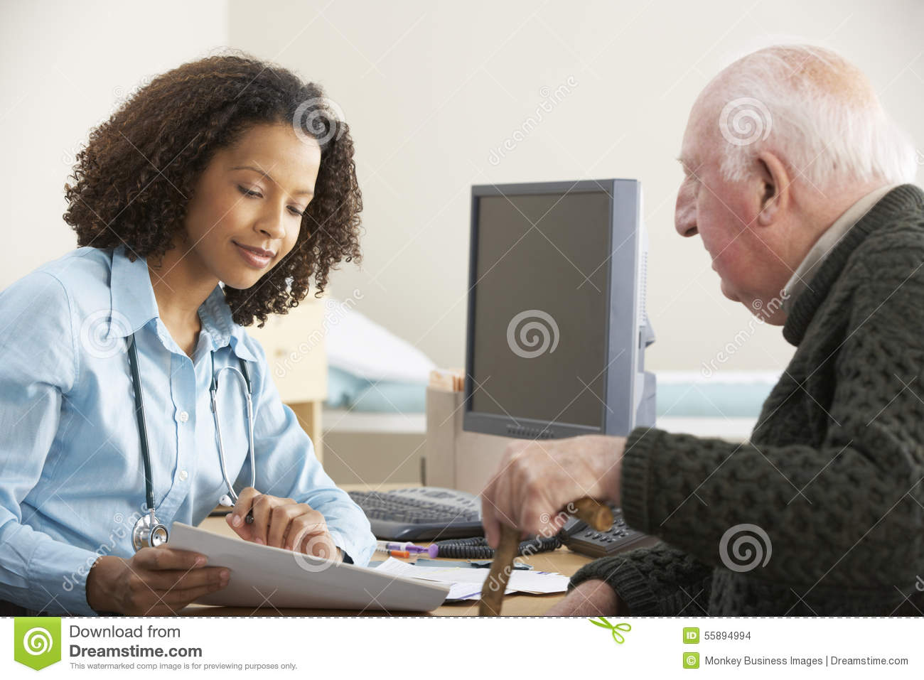 Young Female Doctor With Senior Male Patient Stock Photo -1984