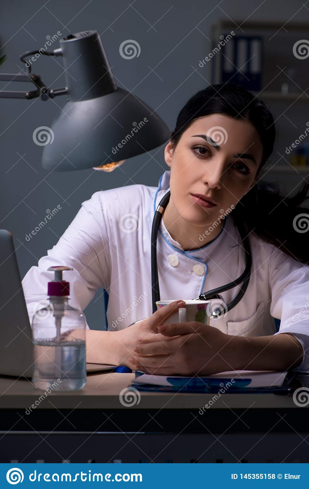The young female doctor working at night shift. Young female doctor working at night shift royalty free stock photos