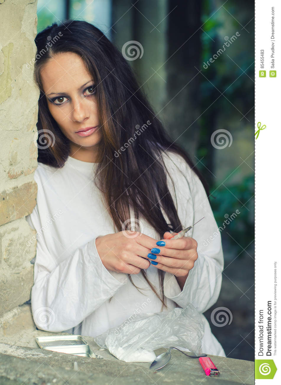 Young Female Drug Heroin Addict In Abandoned Building ...