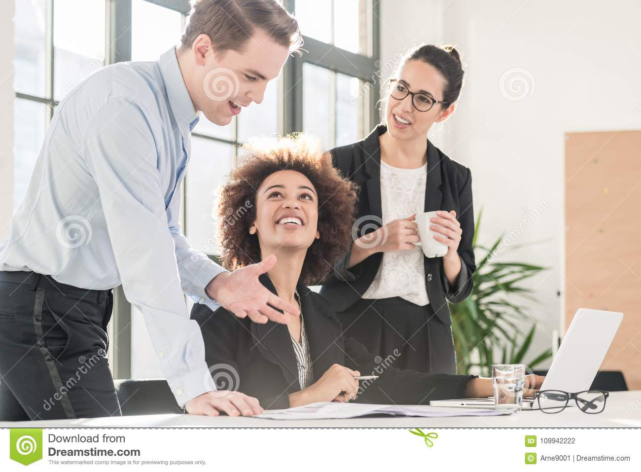 Young female employee asking for advice her experienced colleagu
