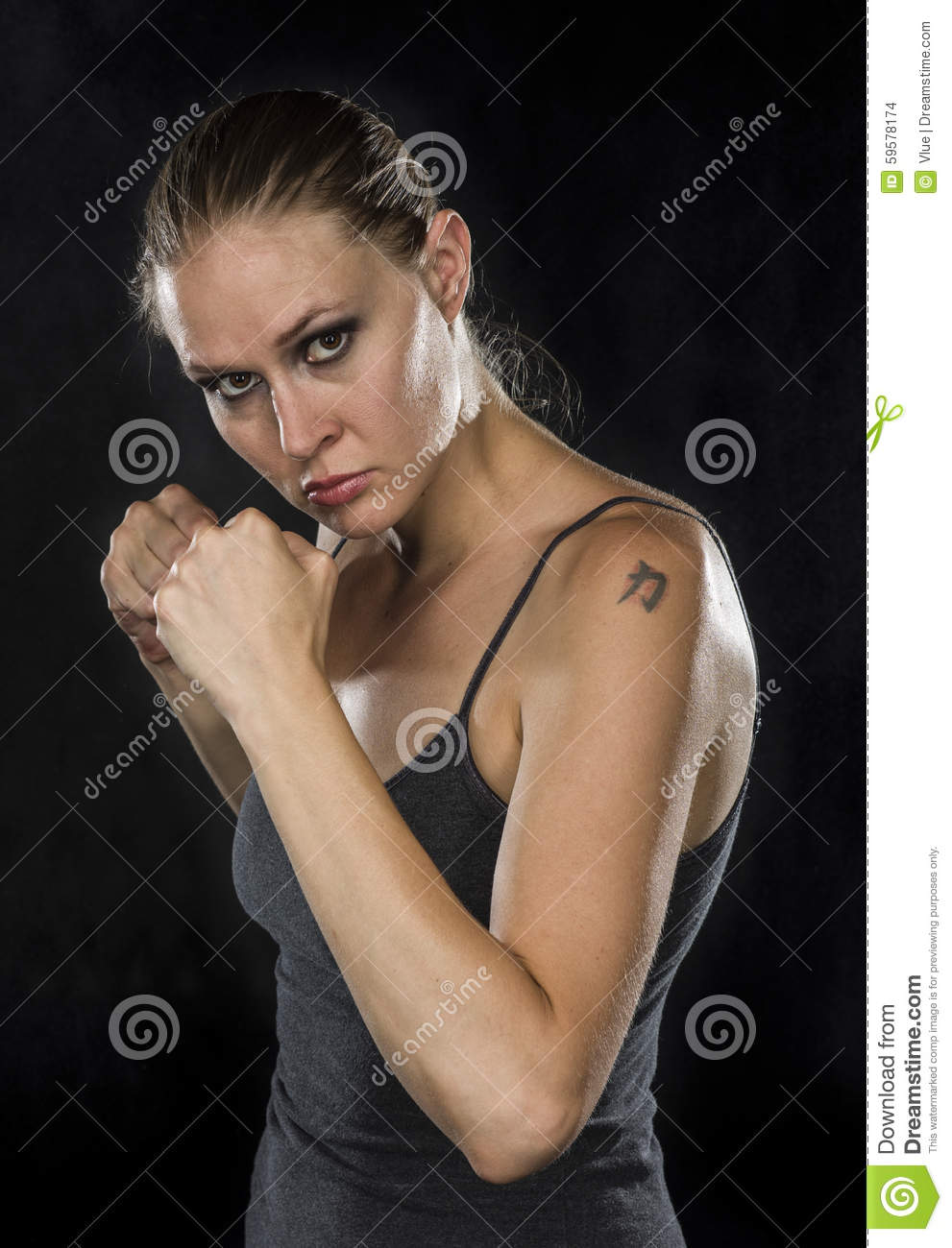 Young Female Fighter Looking Fierce at the Camera