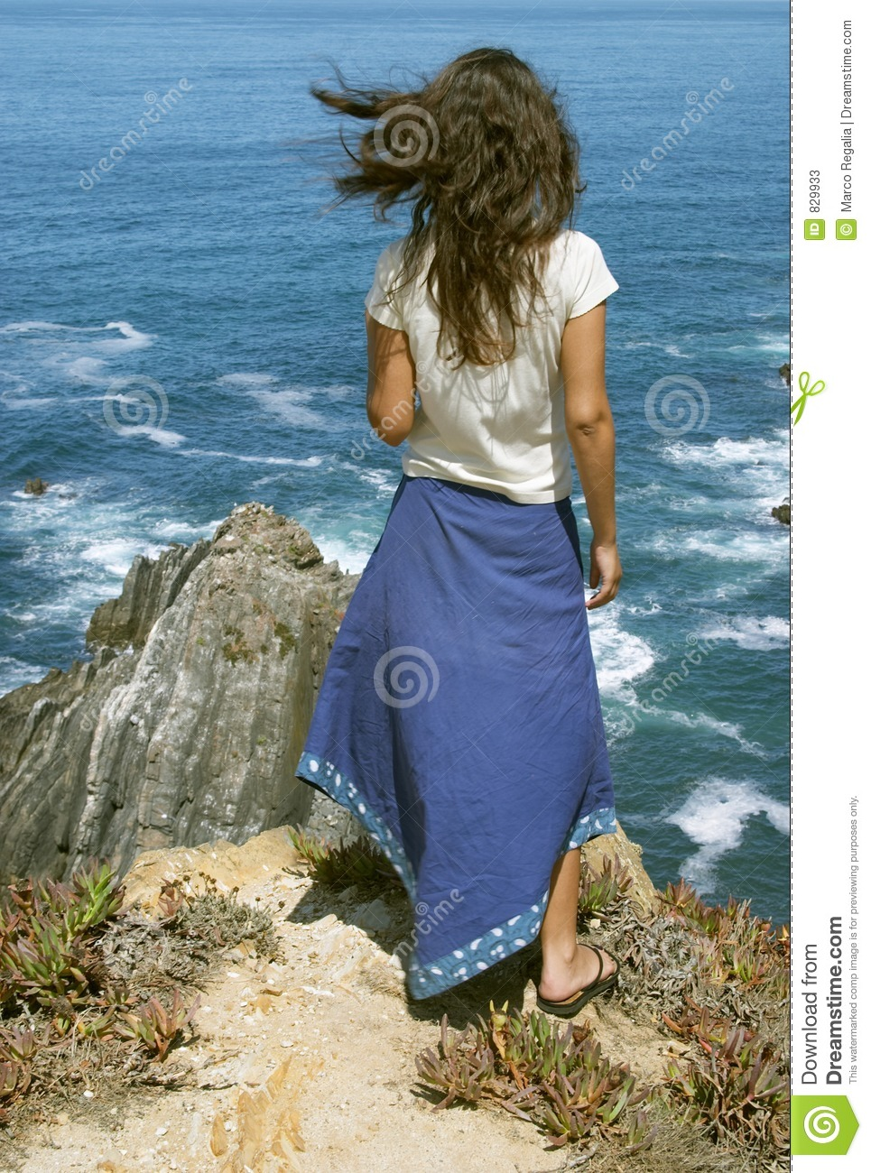 Young female in front of ocean
