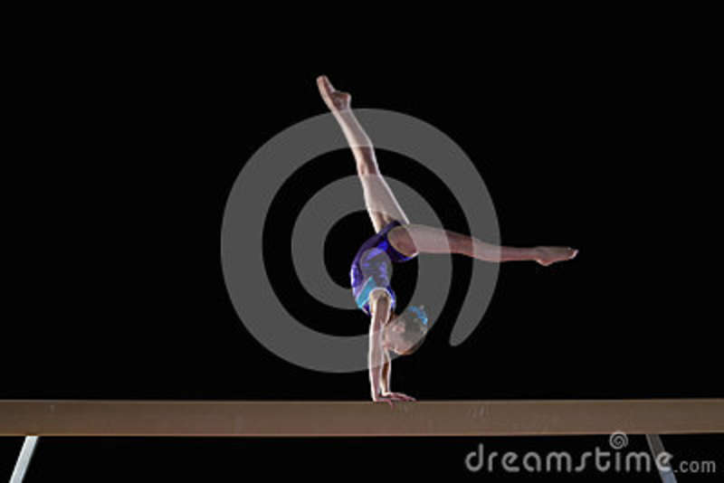 Young Female Gymnast 9 11 Performing Handstand On