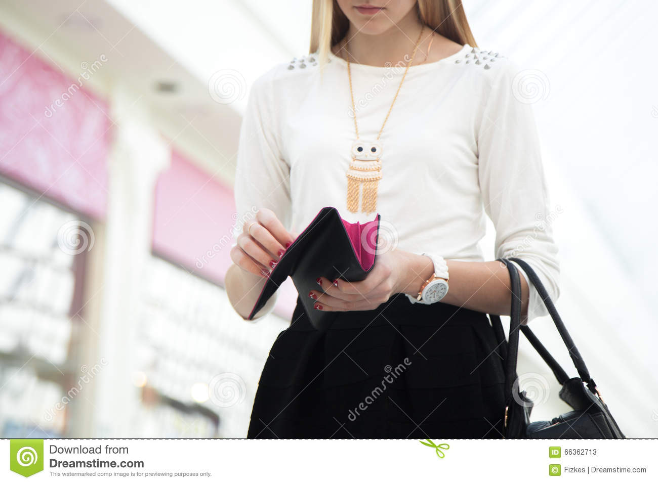 Young female hand holding opened wallet, close-up