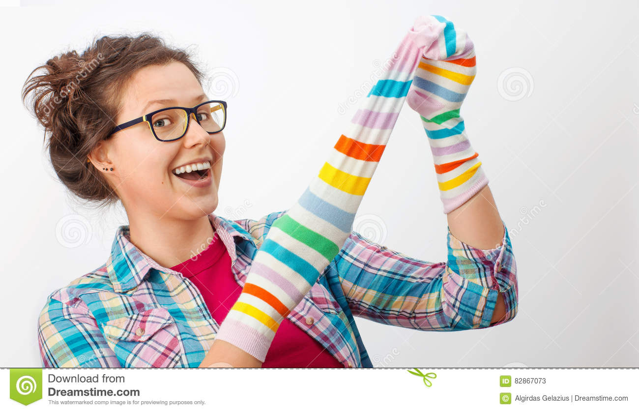 Young female holding two colorful socks