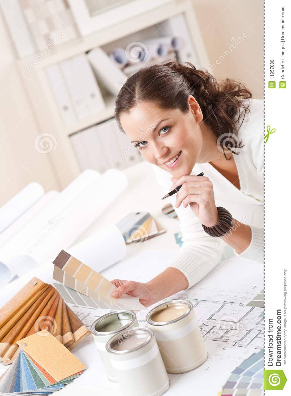 Young Female Interior Designer At Office Stock Photo