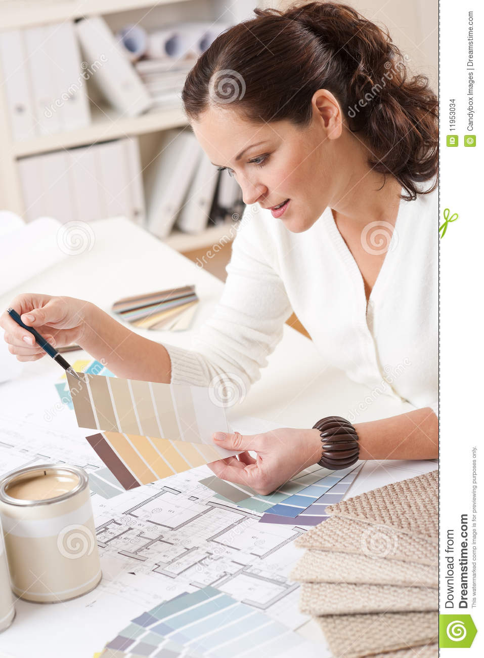 Young Female Interior Designer Working At Office Stock