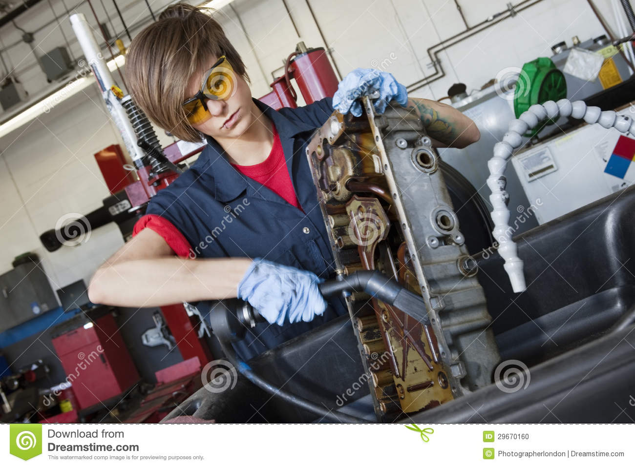 Young Female Mechanic Working With Welding Torch On Vehicle ...