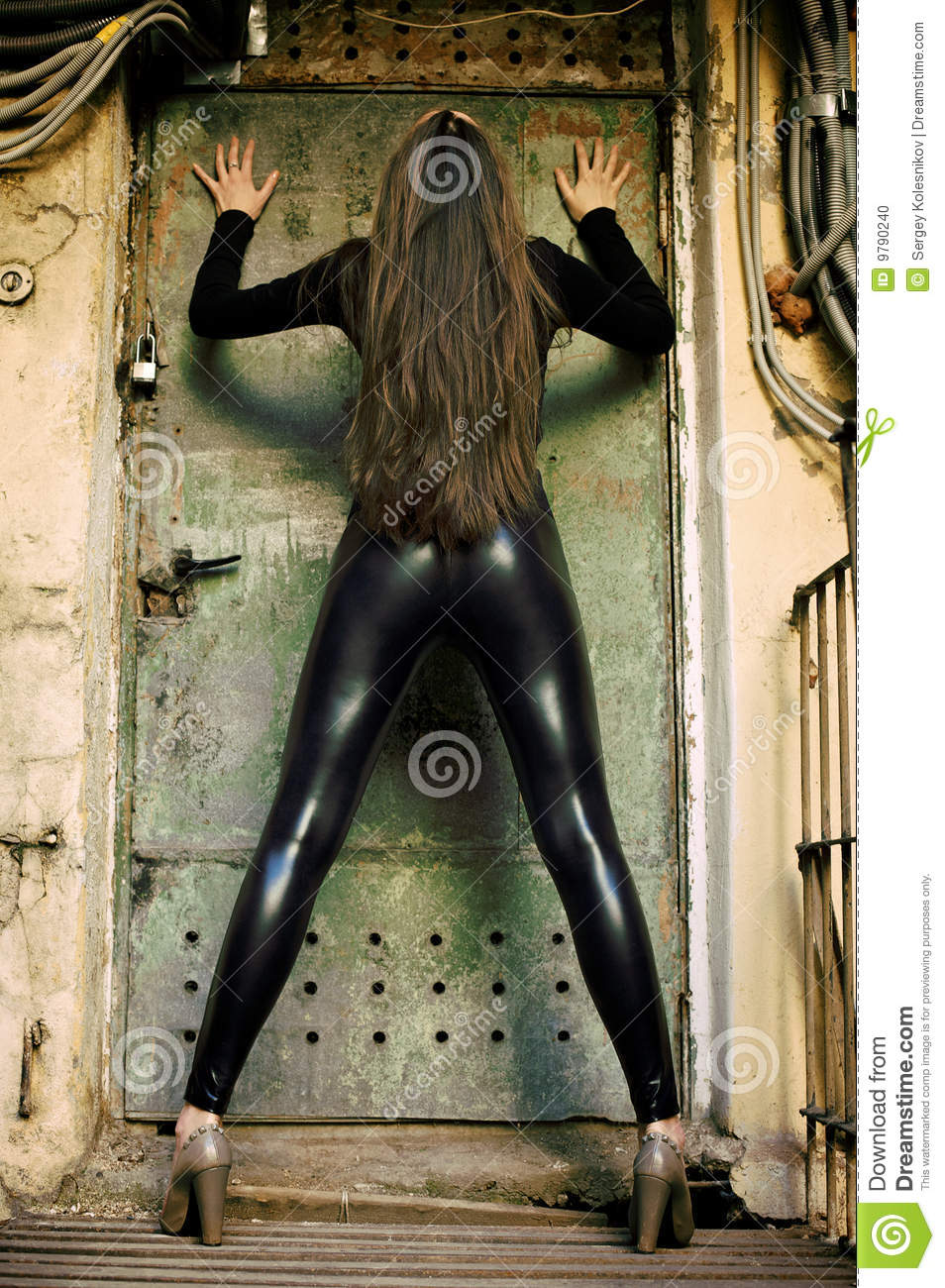 Rusty Door young female model standing before rusty door stock photo - image
