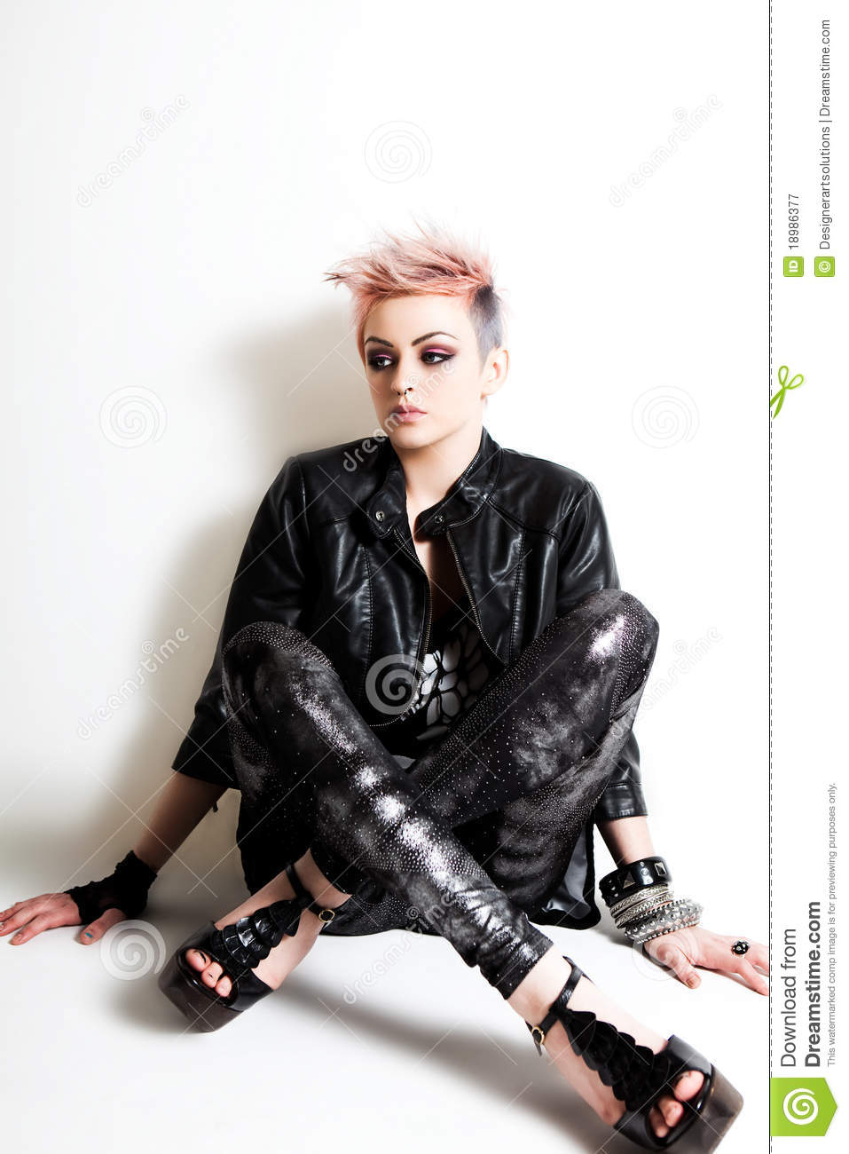 Young Female Punk Sitting Against A Wall Royalty Free