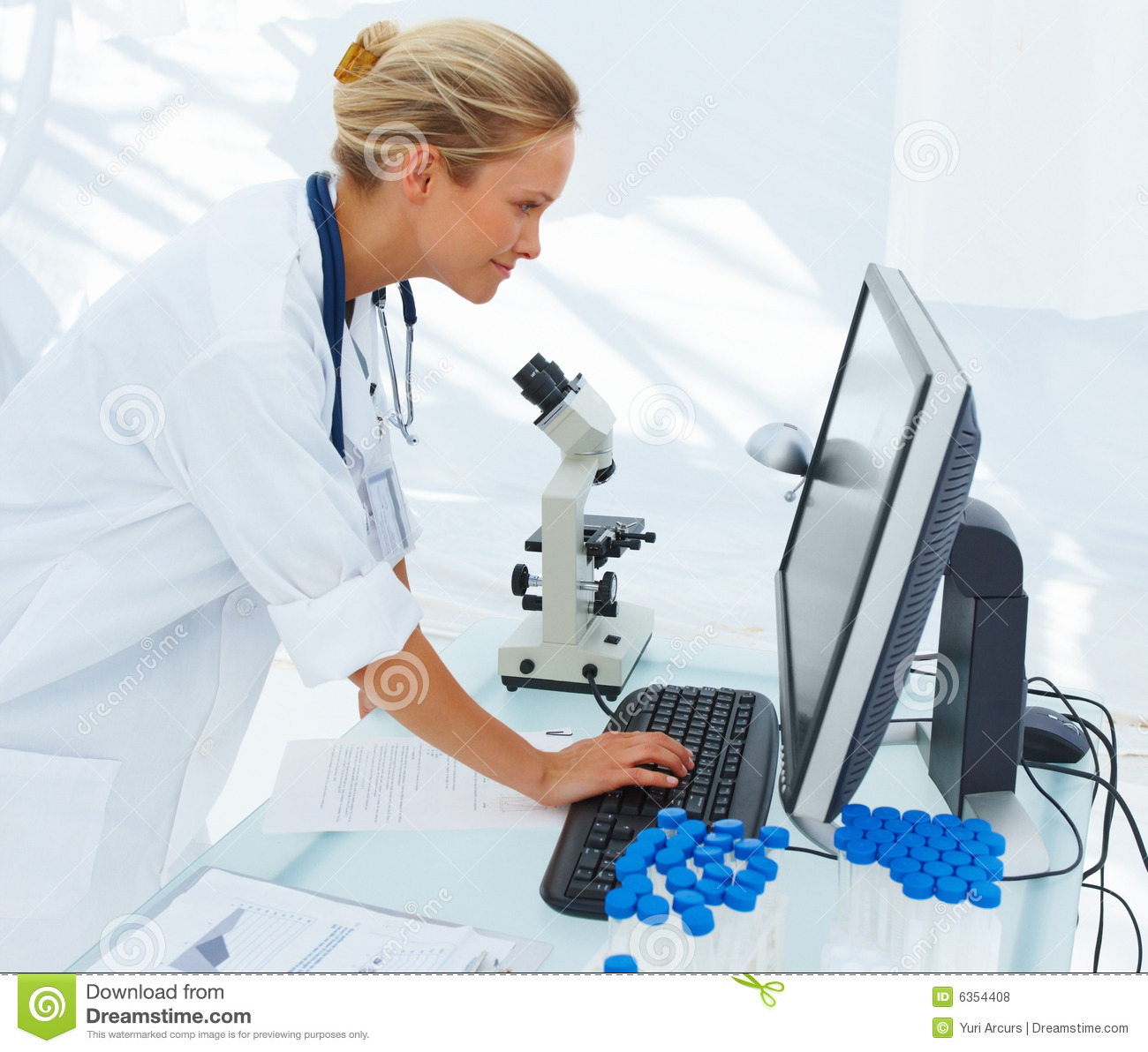 ... Stock Photos: Young female researcher using computer. Image: 6354408