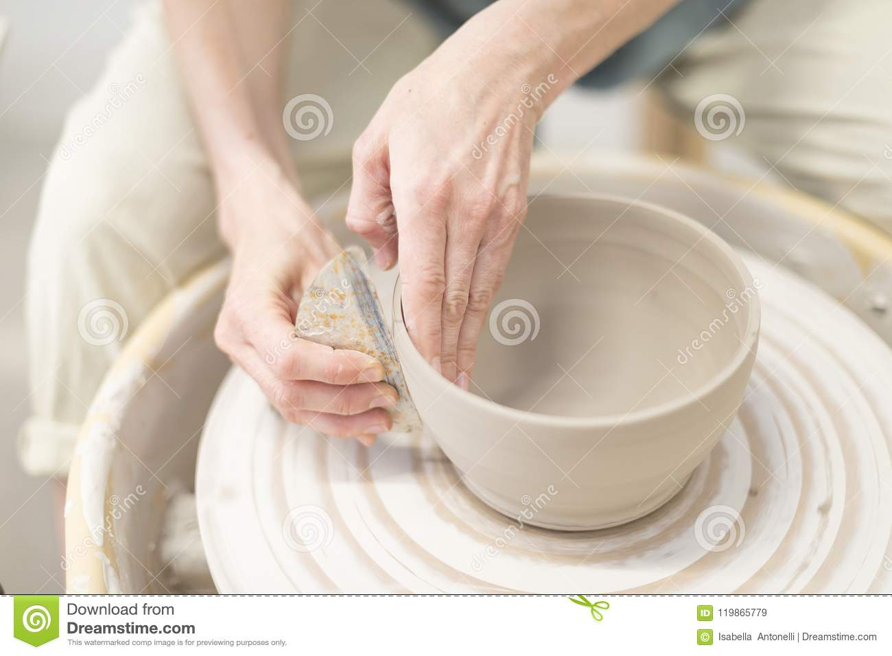 Woman Hands Makes Clay Pot On The Pottery Wheel Stock Image
