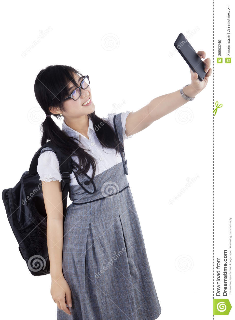 Young asian college student taking photo of self with cell phone ...