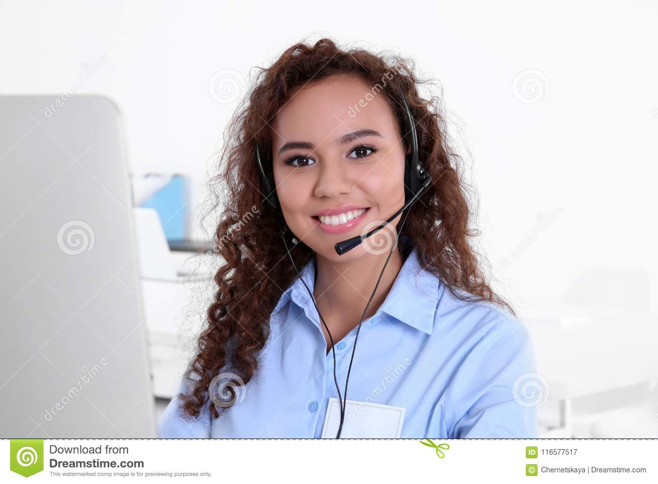 Young female technical support dispatcher working