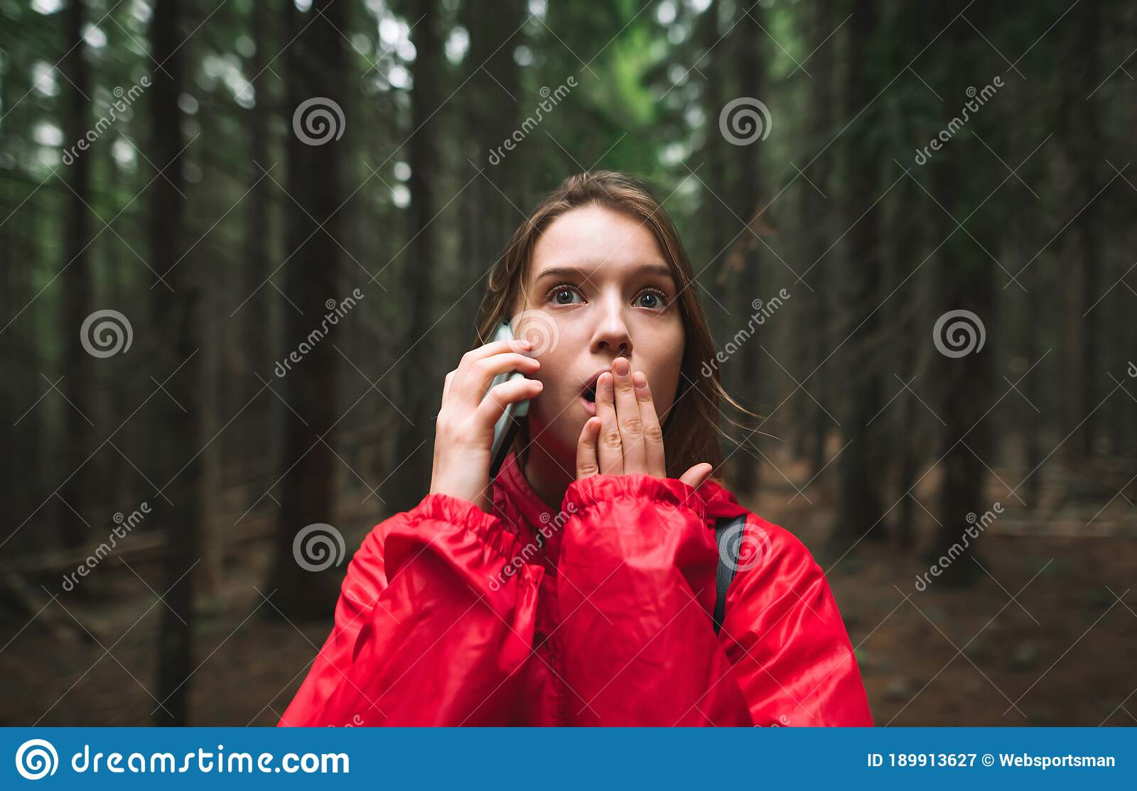 Young Female Tourist Is In Mountain Forest Feeling Scared
