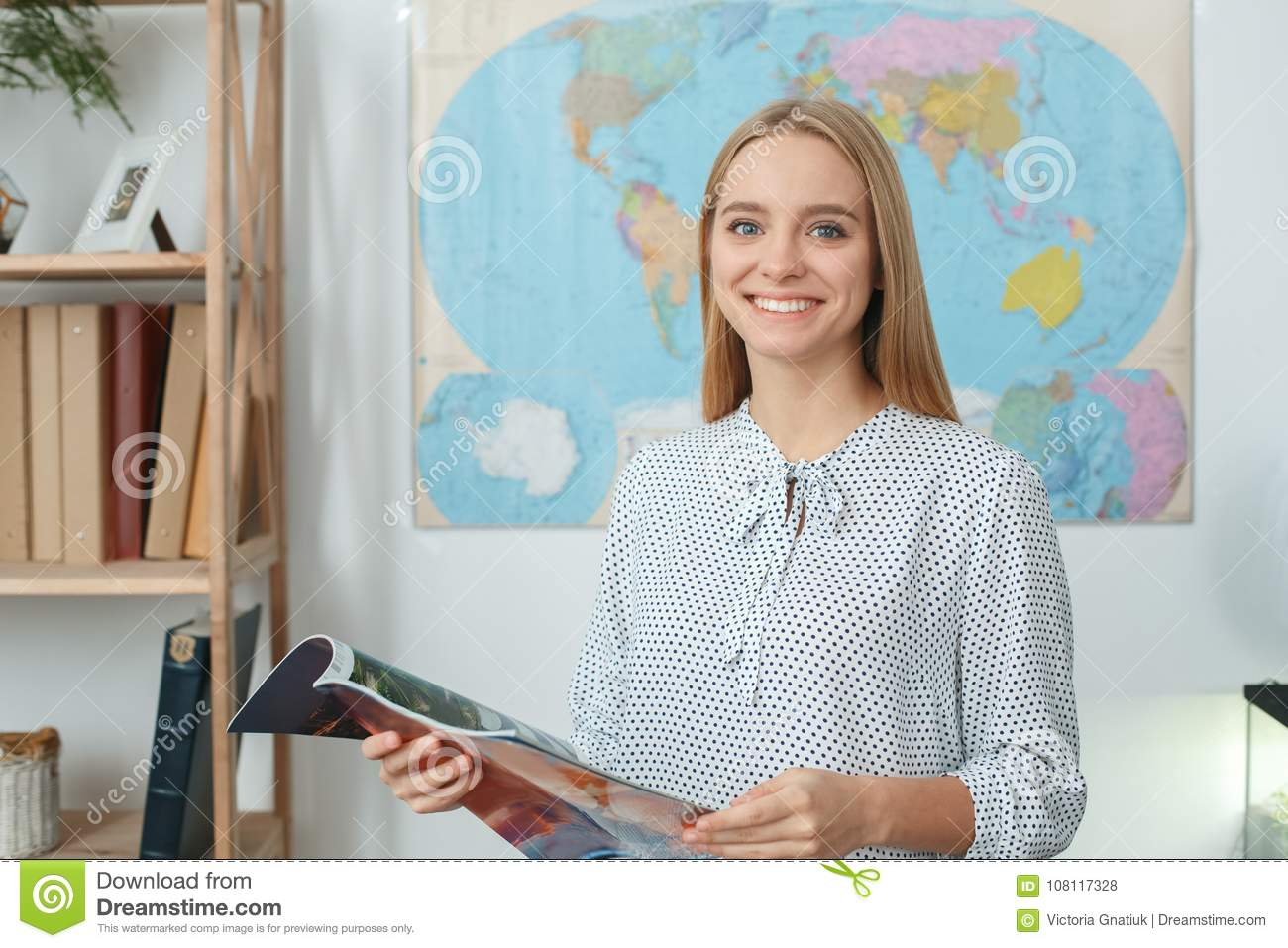 Young Female Travel Agent Consultant In Tour Agency Reading
