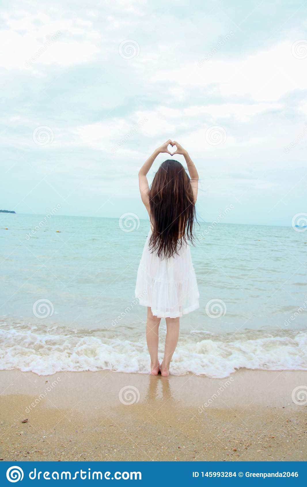 Young female traveler enjoying summer vacations on the beach