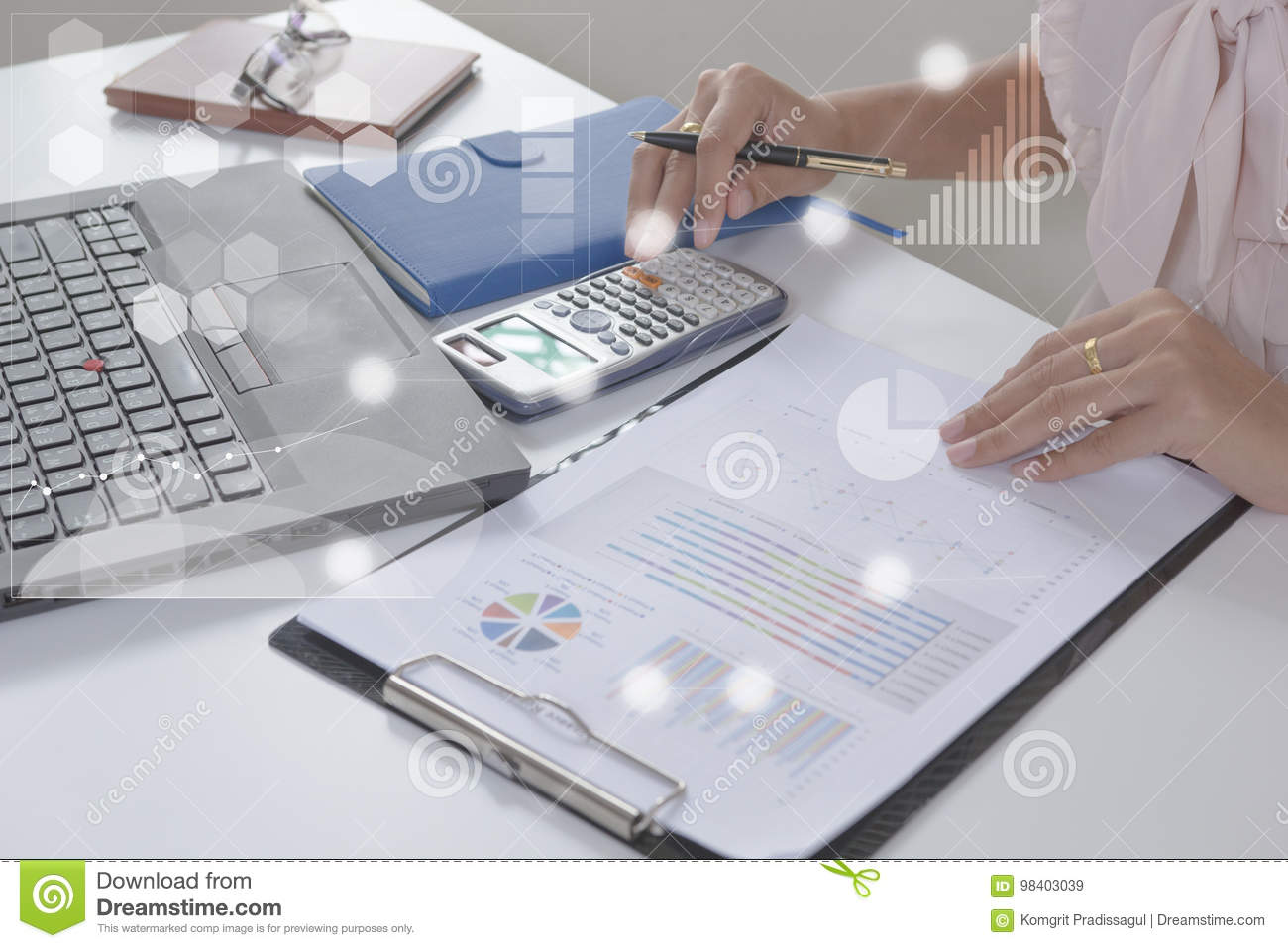 Young finance market analyst working at office on laptop while sitting at white table.Businessman analyze document