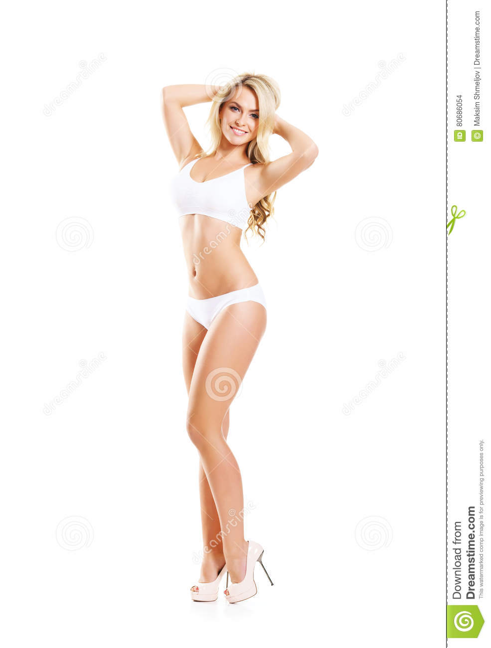 9d3f3c2d660 Fit and sporty girl in white underwear. Beautiful and healthy woman posing  over isolated white background. Sport