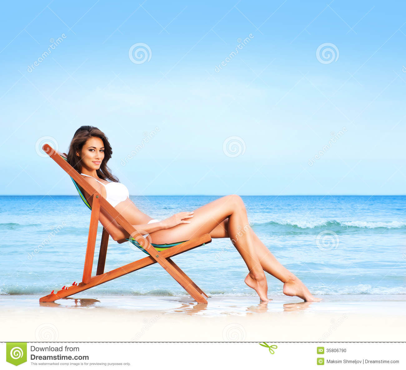 Happy Beautiful Woman Enjoying At Beach Stock Photo: A Young And Fit Brunette Relaxing On A Beautiful Beach