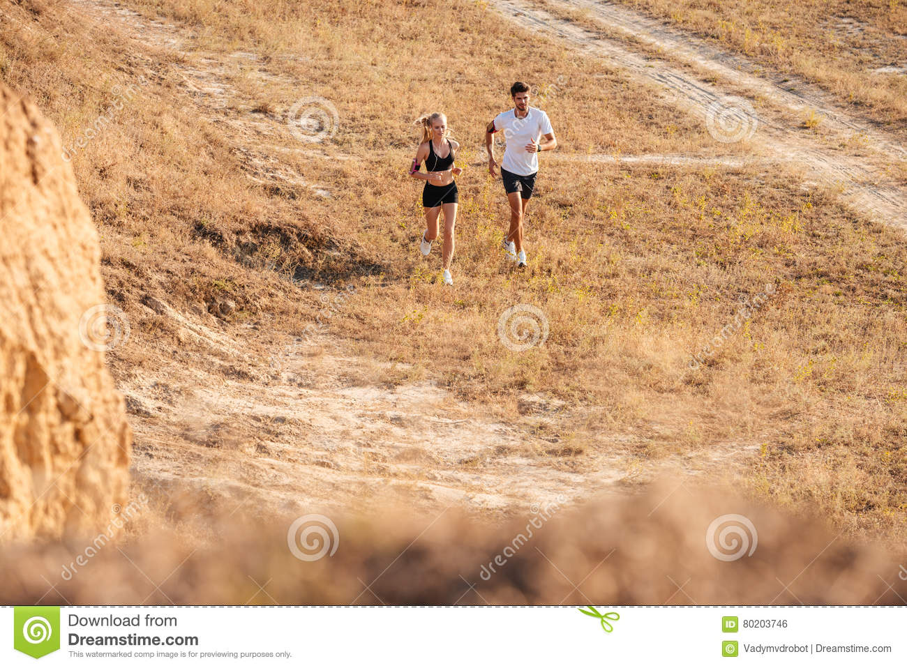 Young fitness man and woman doing jogging sport