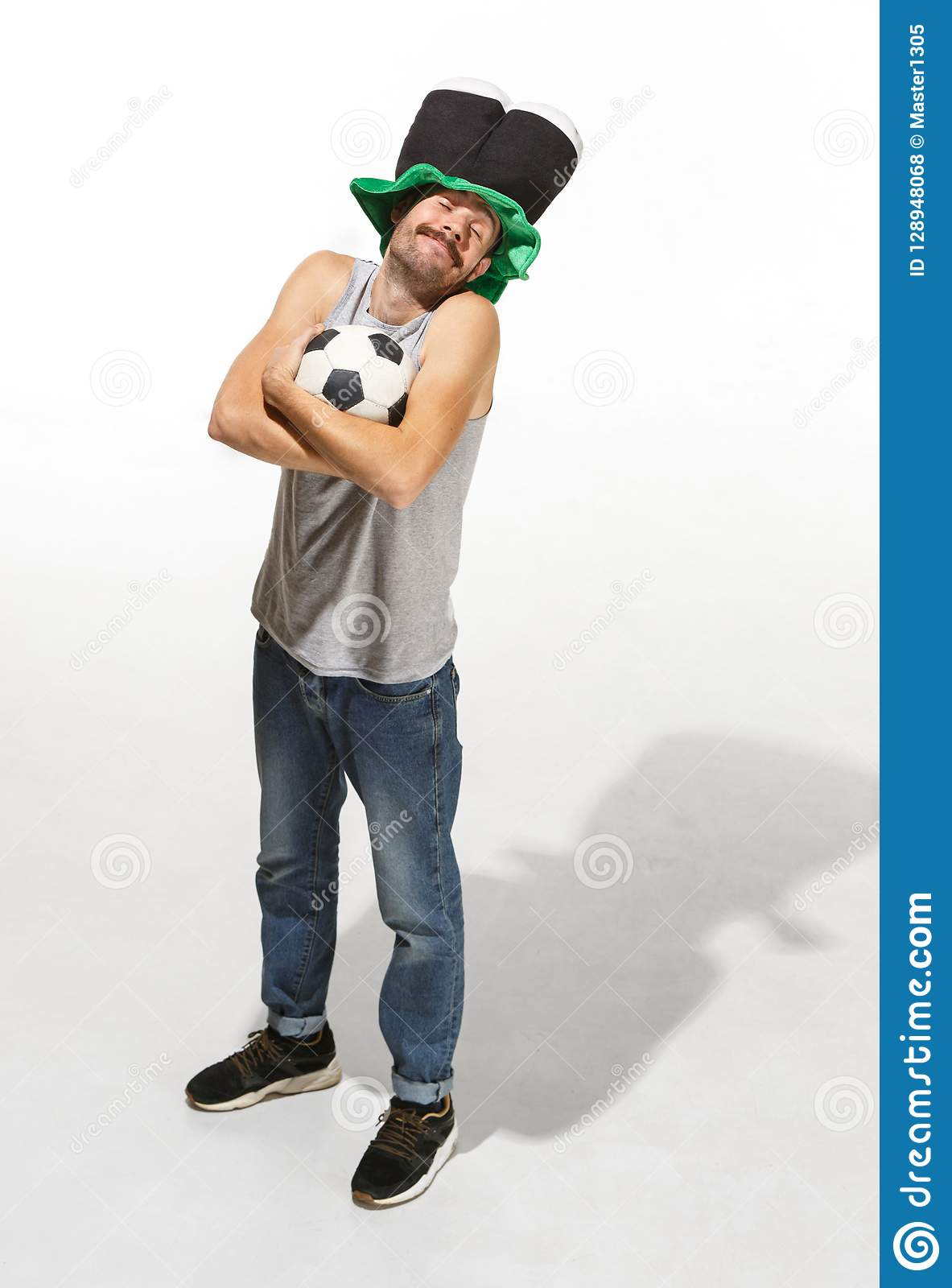 The young football fan - man hugging soccer ball isolated on a white background