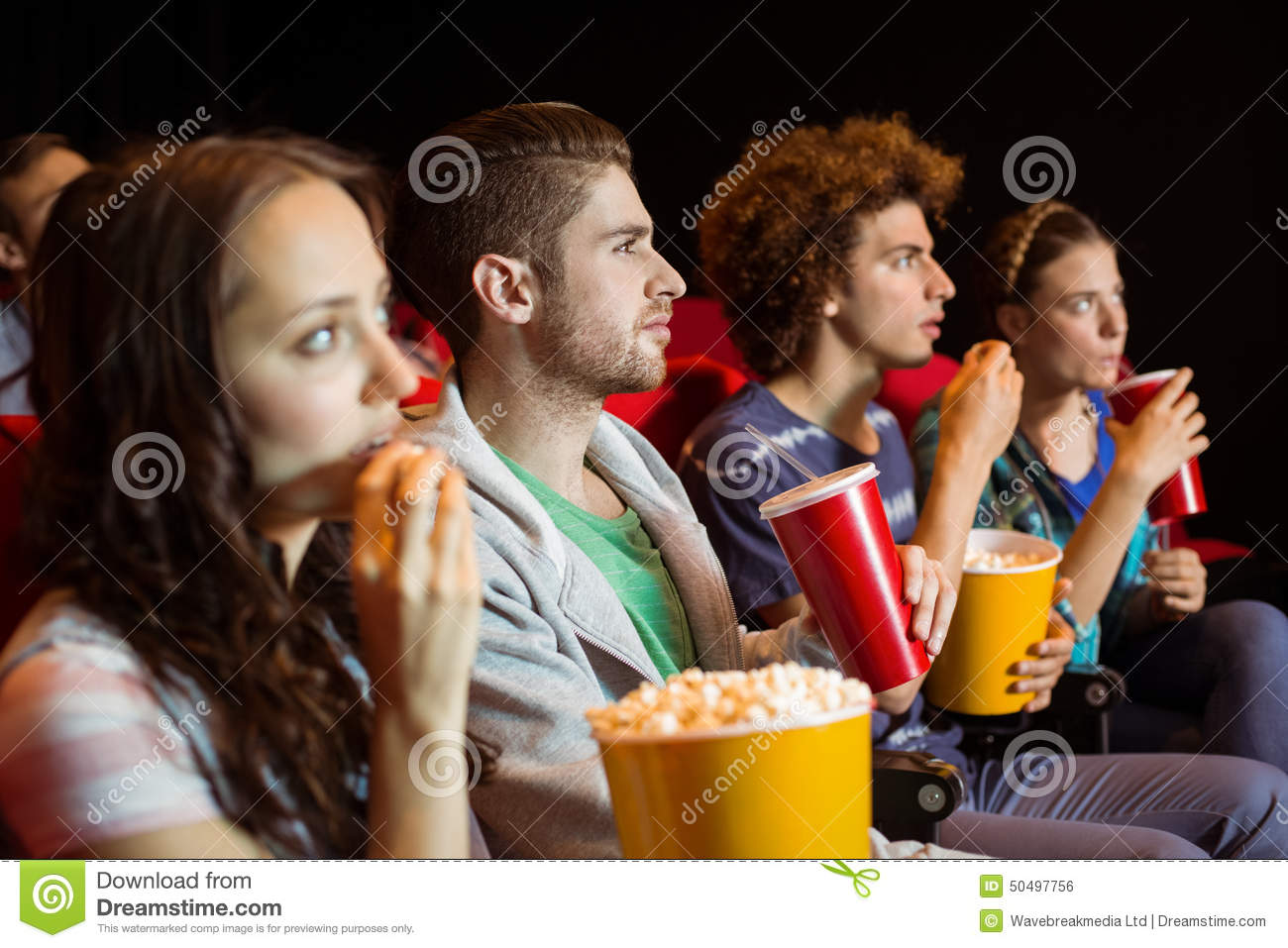 young-friends-watching-film-cinema-50497756.jpg