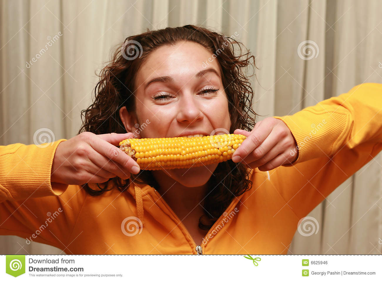 young funny girl eating corn stock photo   image 6625946