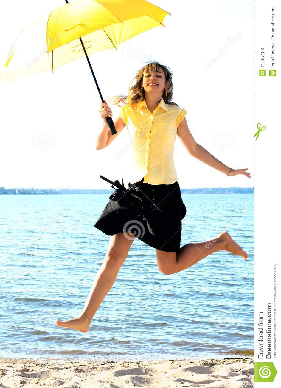 Young Funny Girl Jumping With Umbrella