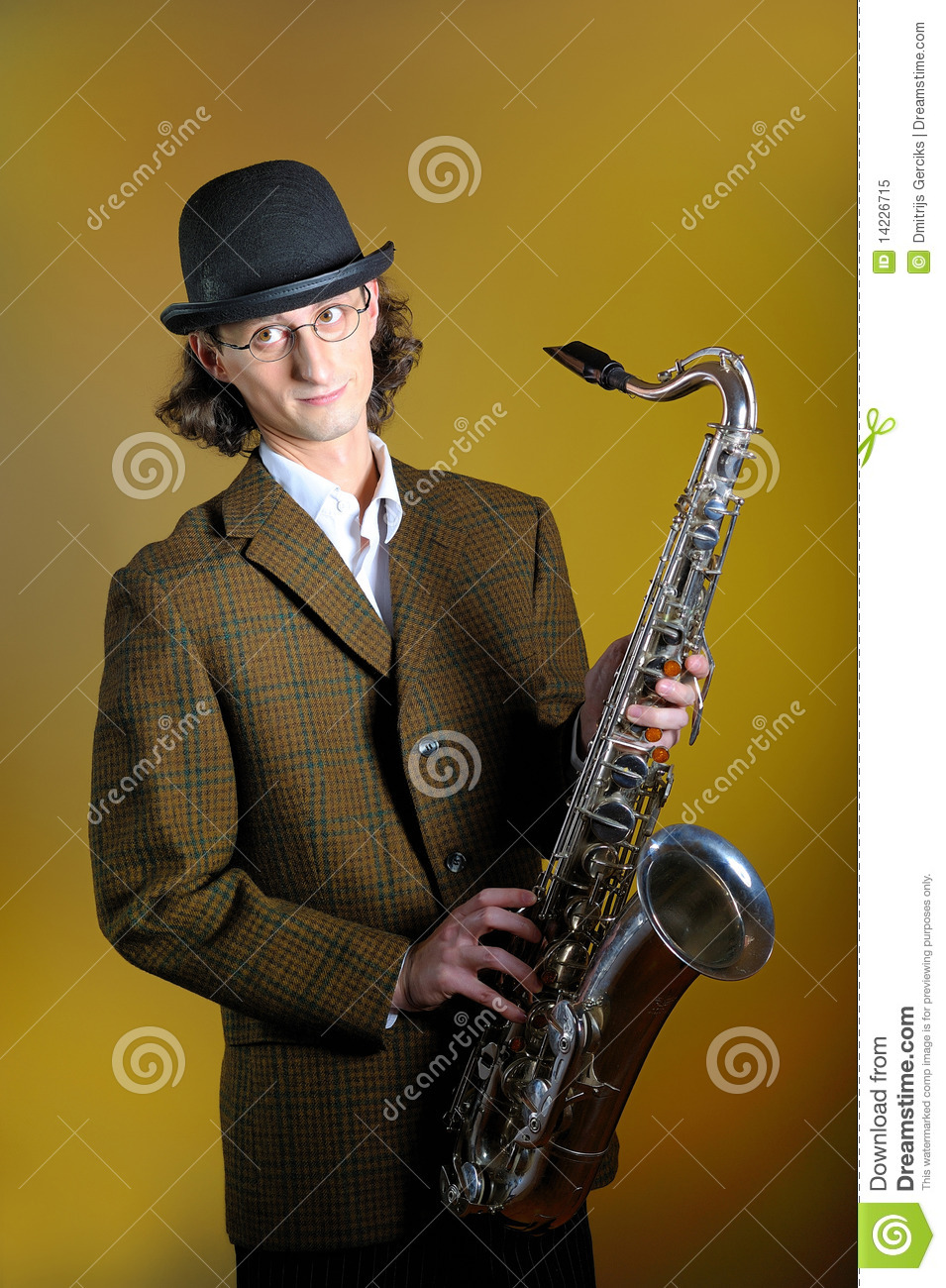 Young Funny Man In Bowler Hat Holding Saxophone Royalty