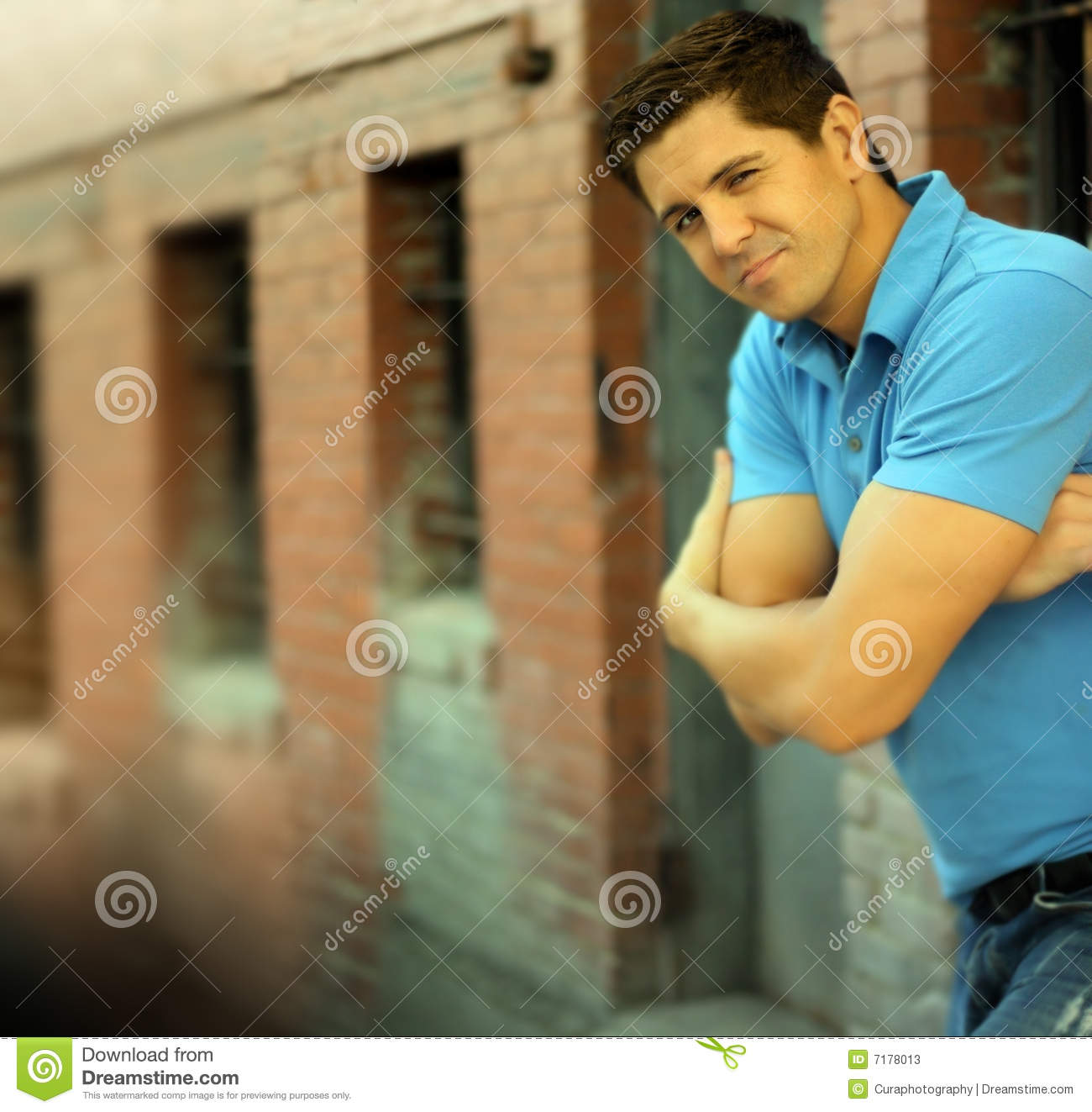 Young Funny Man Folding Arms