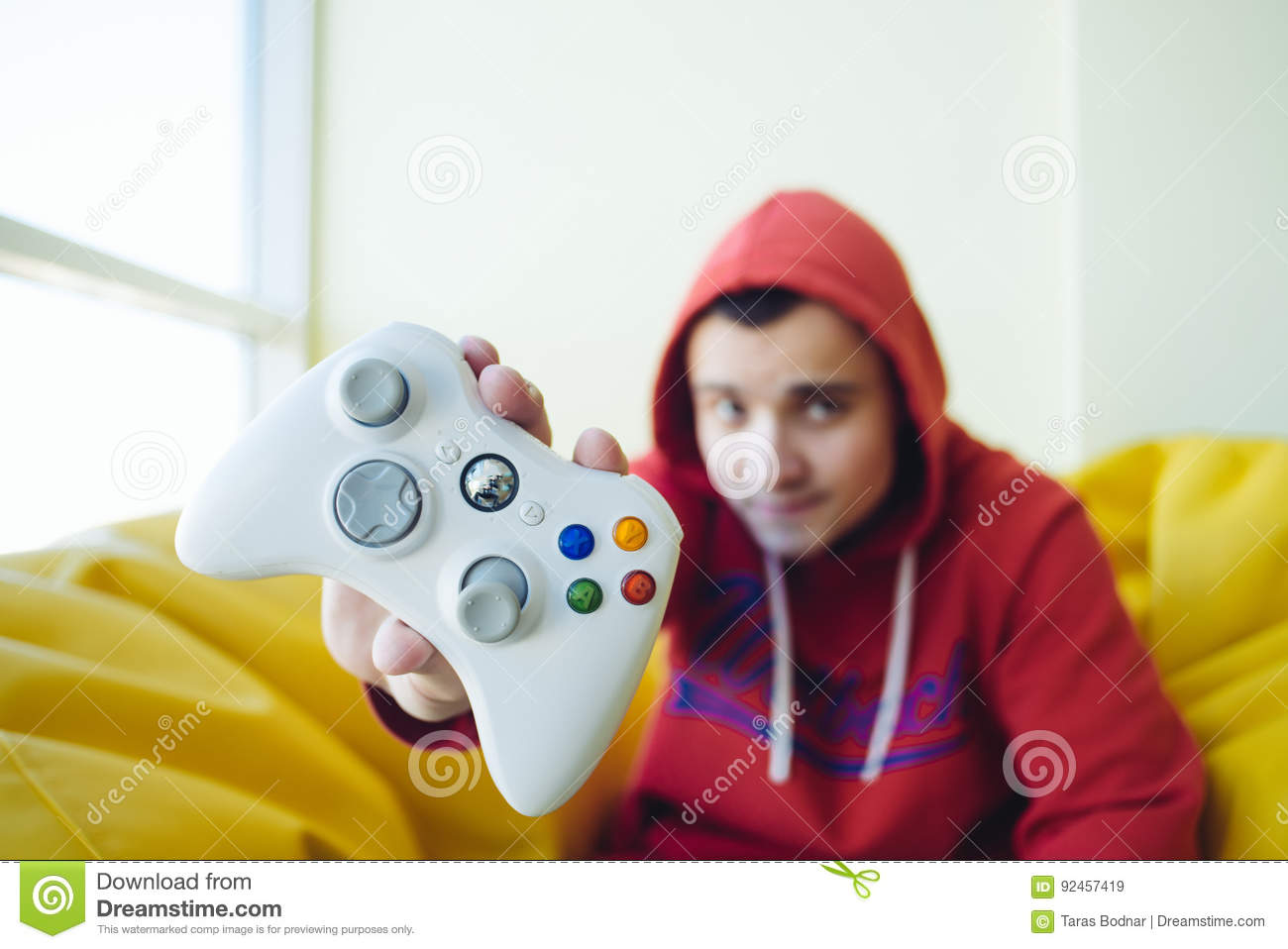 A young gamer shows a white gamer gaming joystick close up. Concept Video Games.