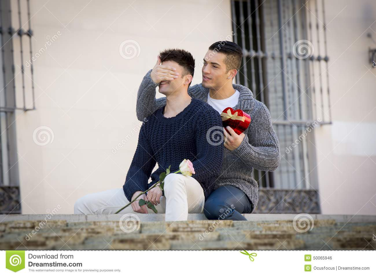 Gifts For Young Men: Young Gay Men Couple With Rose And Box Present Celebrating