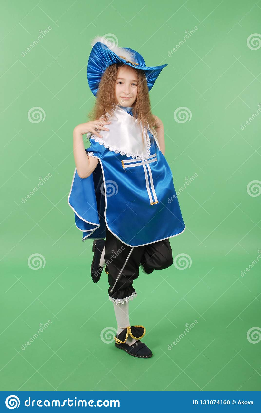 Young girl as a musketeer in blue costume with lovely blue hat with feathers