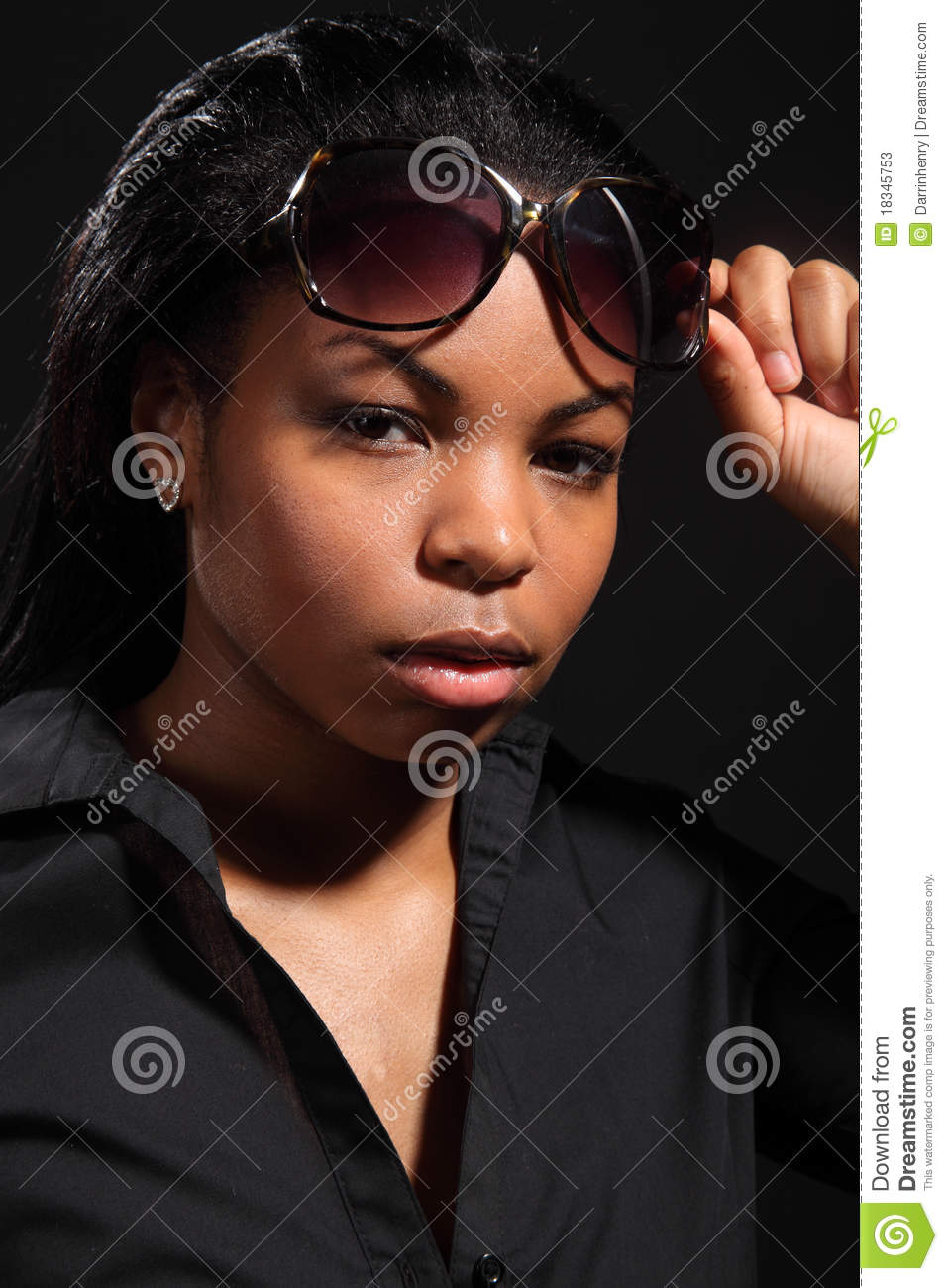 Young girl with attitude wearing sunglasses