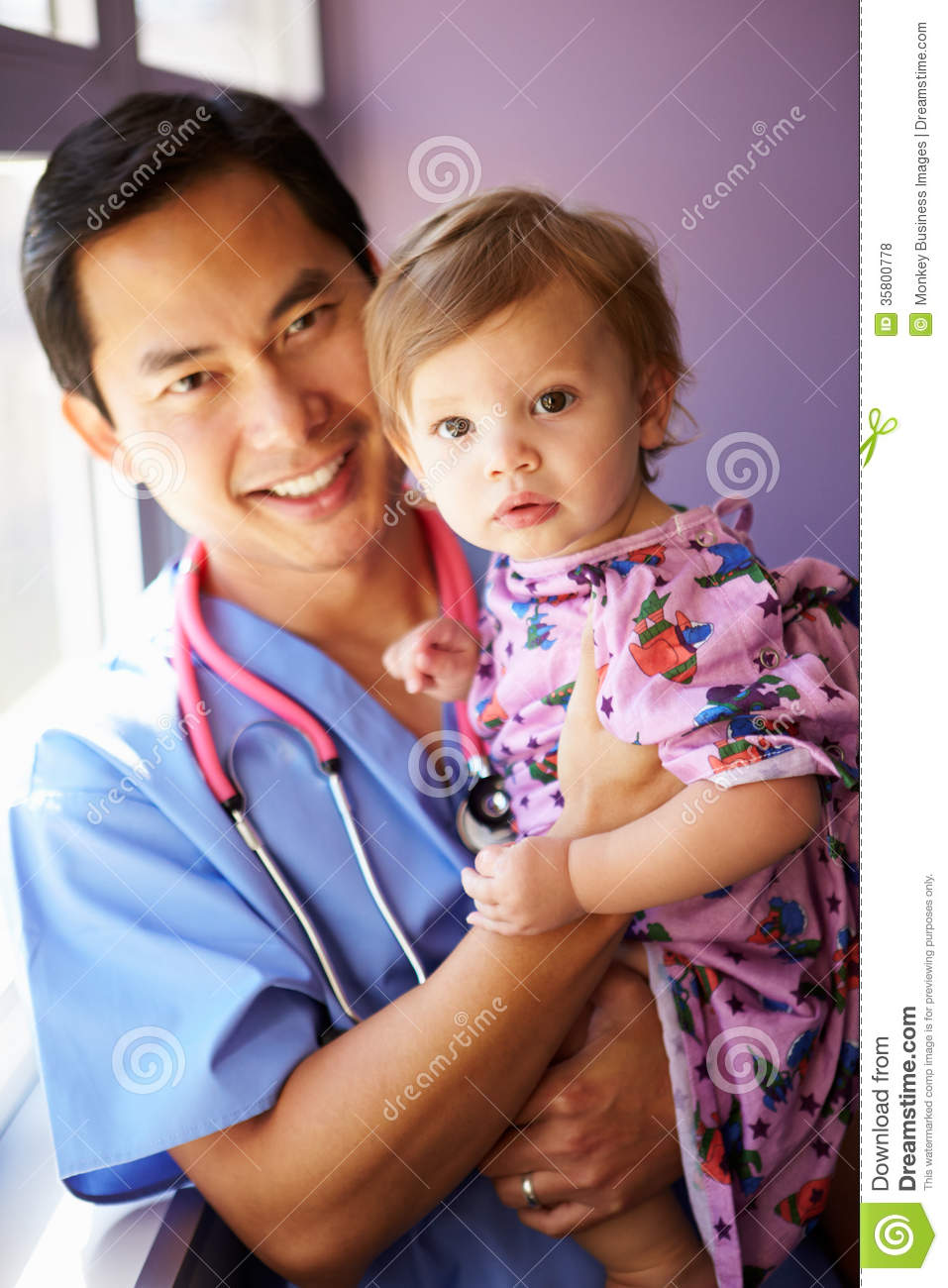Young Girl Being Held By Male Pediatric Nurse Royalty Free