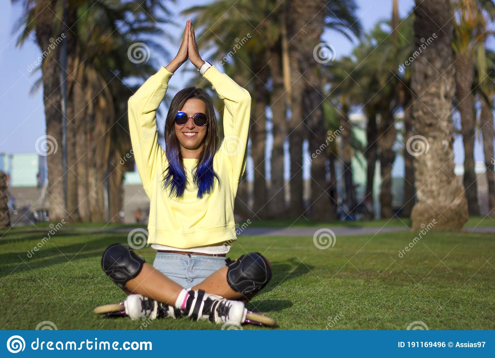 Young Woman Lying On The Green Grass Stock Photo - Image