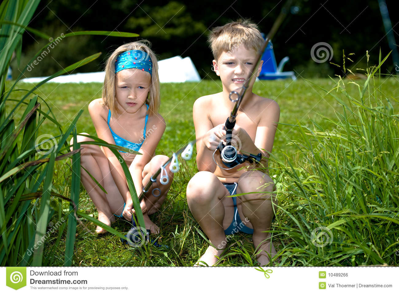 Young girl and boy fishing royalty free stock image for Fishing times free
