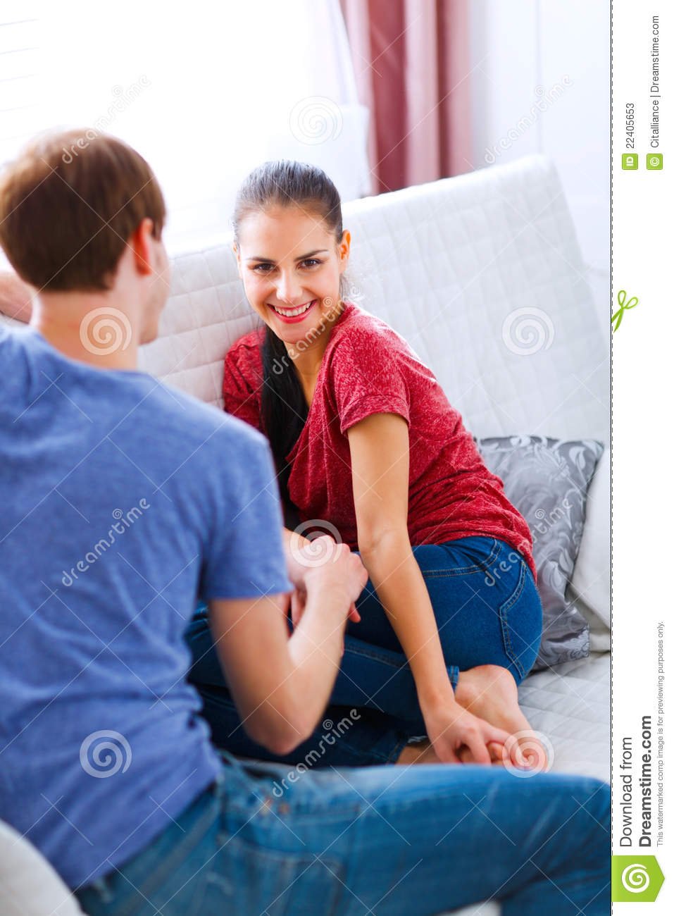 young girl with boyfriend relaxing at home stock photos. Black Bedroom Furniture Sets. Home Design Ideas