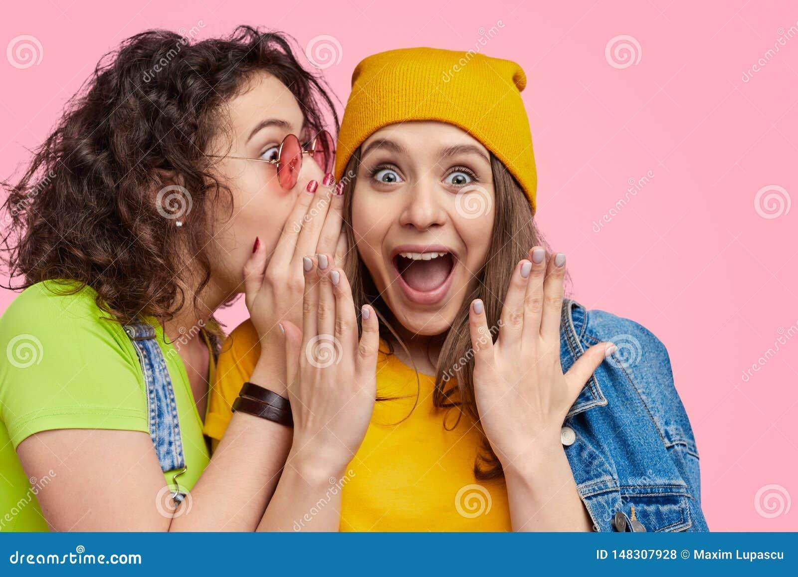 Female sharing secret with best friend