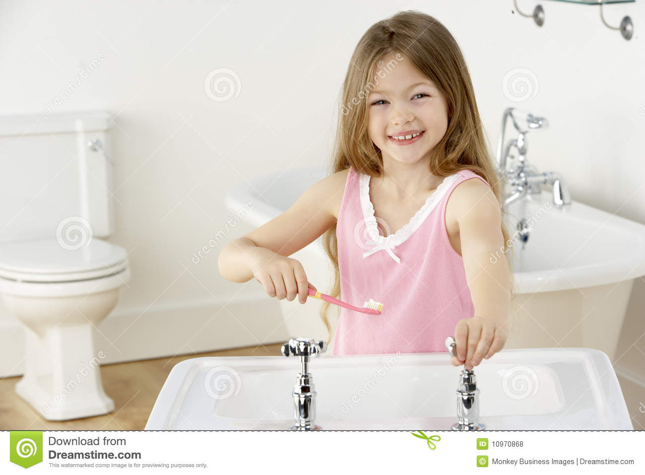 Young Girl Brushing Teeth At Sink Royalty Free Stock