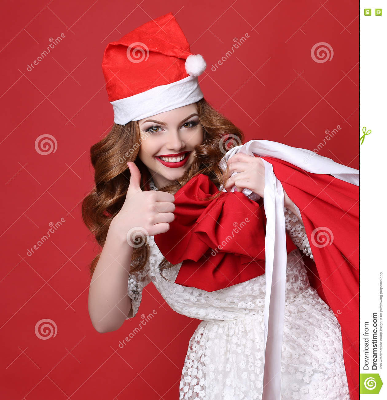 Young Girl With Charming Smile, In Santa Hat, With Big Bag