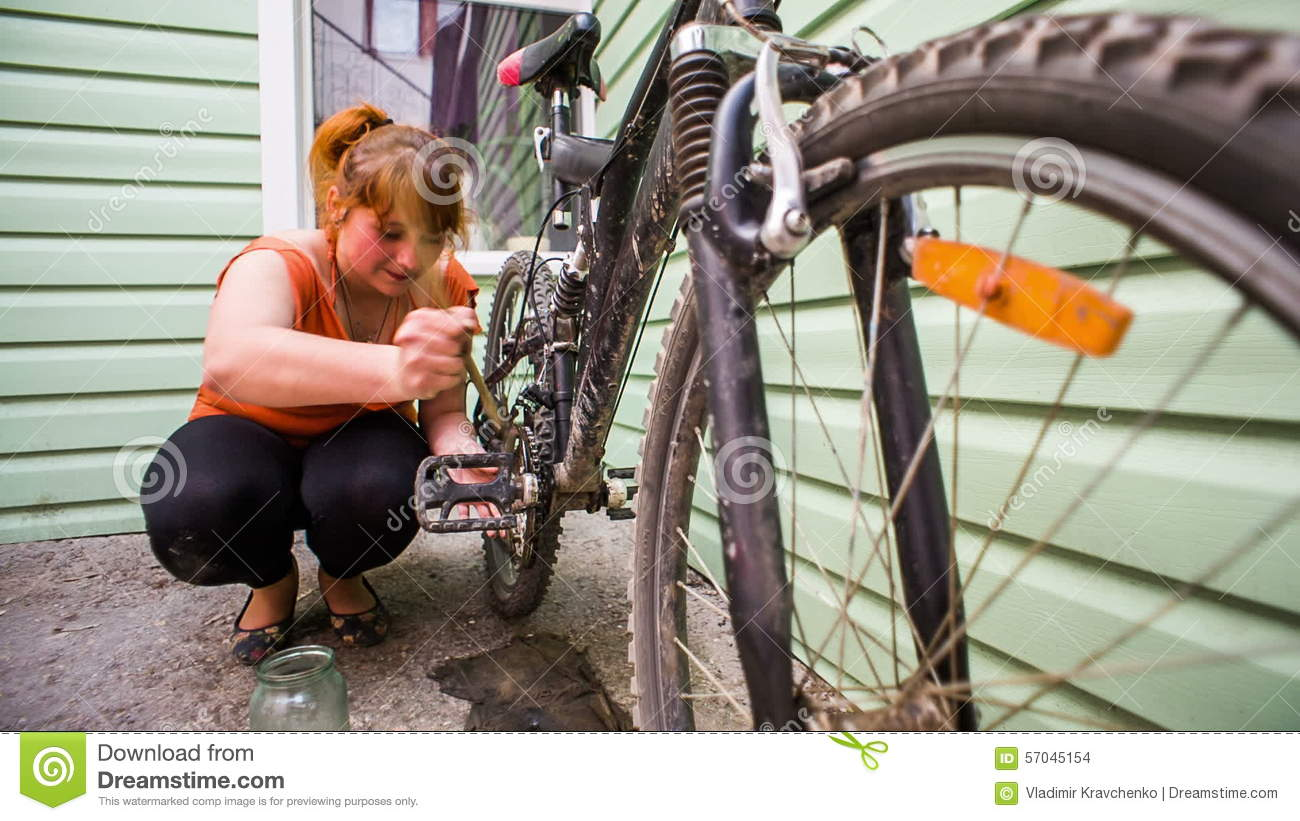 Young Girl Cleaning Her Bicycle With Brush And Stock Footage - Video ...