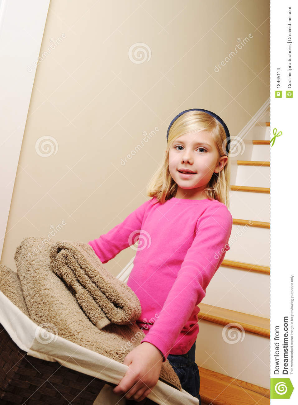 young girl cleaning laundry stock images