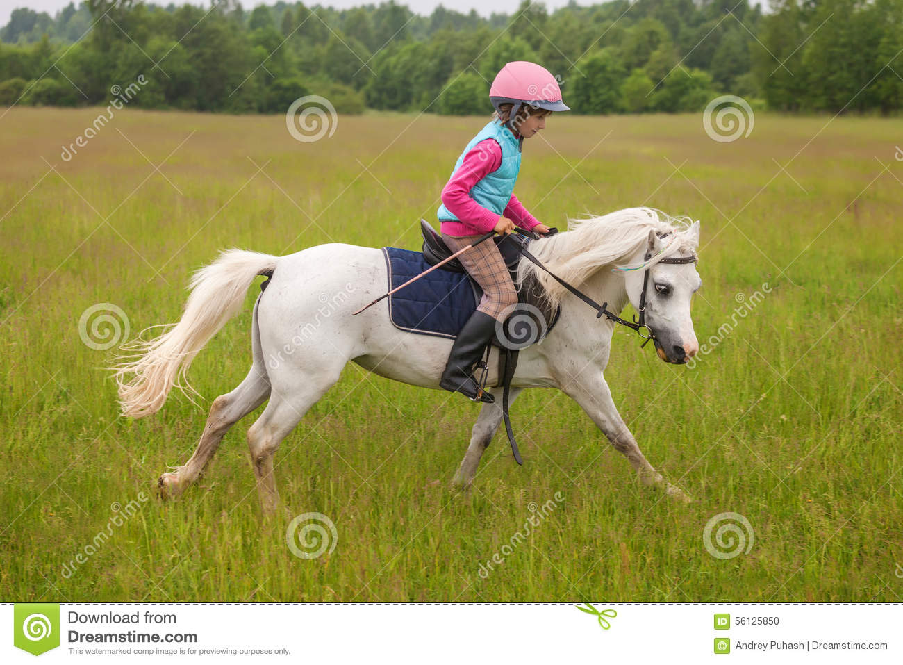 Young girl confident galloping horse on the field
