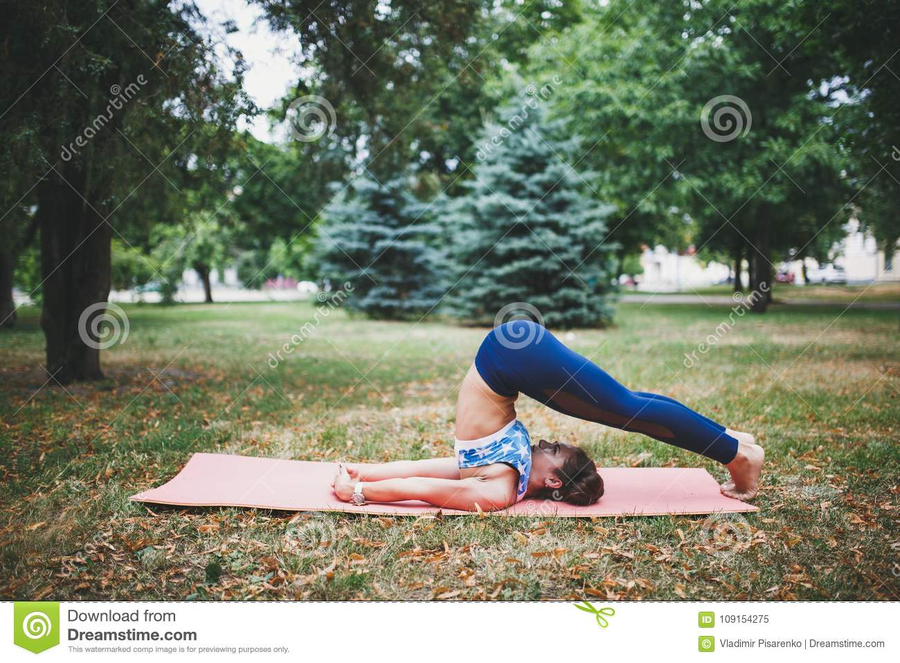 Young girl doing yoga exercise outdoors.